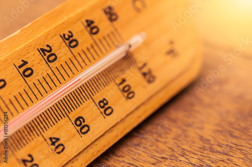 Obraz na plátne  hot day summer concept closeup thermometer with warm color tone
