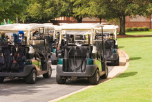 Electric Golf Carts Parked Out...