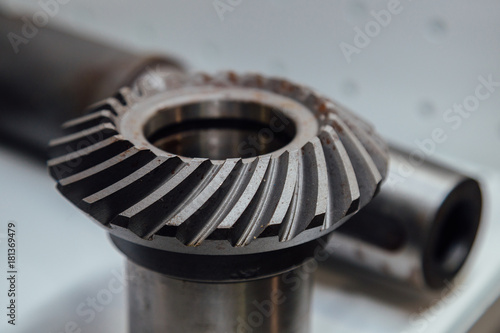Valokuva  Bevel gear on the shaft, close up view