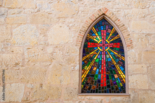 Fotomural  Gothic style church window with stained glass/ red cross made of stained glass