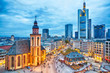 View to skyline of Frankfurt in sunset blue hour. St Paul's Church and the Hauptwache Main Guard building at Frankfurt central street Zeil.