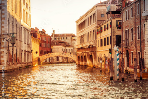 Canal in Venice at sunset, Italy. Beautiful view of Venetian street.
