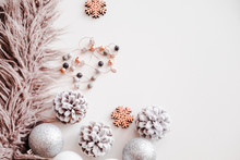 Woman Christmas Background On White. Frosty Pine Cones, Silver Colored Decoration Balls, Faux Fur, Jewelry. Copyspace For Text, Overhead, Horizontal