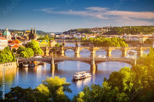 Fototapeta View of the Vltava River and the bridges shined with the sunset sun, Prague, the Czech Republic obraz na płótnie