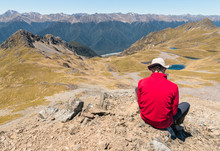 Hiker In Red Fleece Resting Ab...