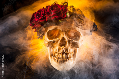 Poster Crâne aquarelle The skull of a man in the smoke. Skull with a wreath of flowers.