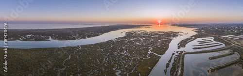 Fotografía  Aerial sunset seascape in Ria Formosa wetlands natural park, inland maritime channel