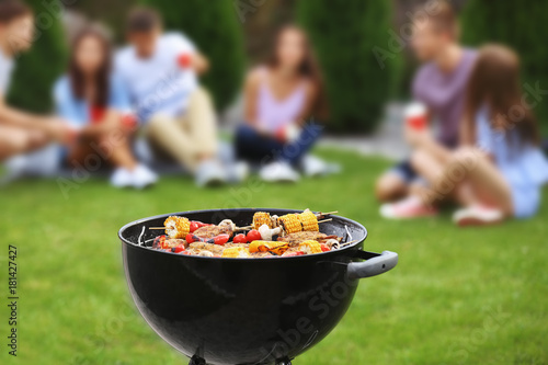 Tasty steaks and vegetables cooking on barbecue grill, outdoors