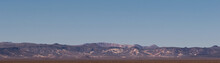 A Distant Mountain Range With Blue Skies