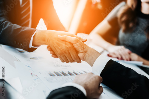 Photo business brainstorm meeting conference table with people consulting with graph c