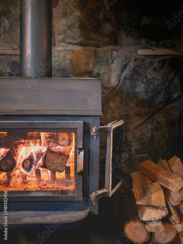 Cast-iron Fireplace Burning on Stone Hearth Wallpaper Mural