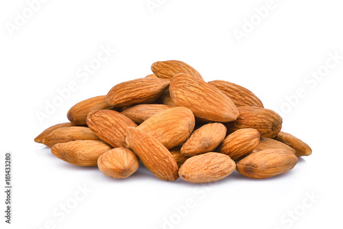 pile of almonds seeds isolated on white background