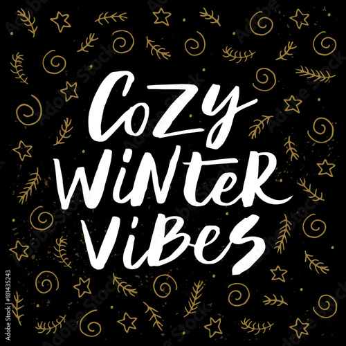 Printed kitchen splashbacks Christmas Cozy winter vibes - trendy brush hand lettering isolated on black background with gold holiday elements. Greeting card for the winter season. Vector illustration.