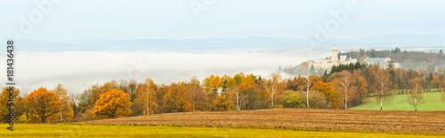Fotografiet Castle Hluboka nad Vltavou with autumn trees and fog, Czech landscape