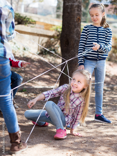 Aluminium Prints Mountaineering children games. Girl goes through the tangled rope
