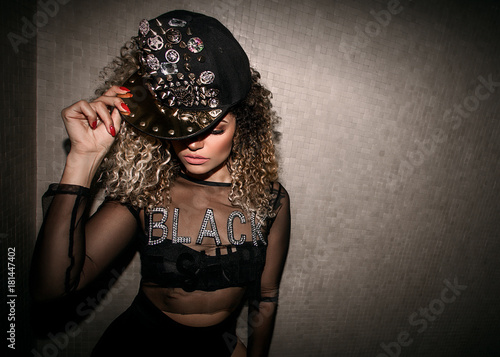 Fotografie, Obraz  Woman wearing transparent shirt and wearing hip hop cap