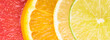 Abstract background with motley citrus-fruit slices, close-up background
