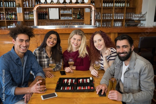 Friends having glass of beer in bar Canvas Print