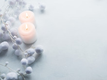 Candles On White Background. Winter Decor. Coziness Spa Concept