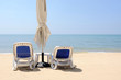 Beach chairs on beautiful sand beach