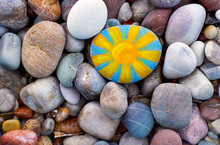 Bright Sun Painted On Pebble.