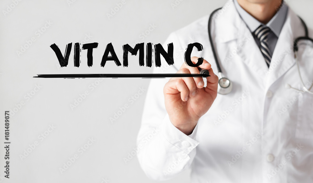 Fototapeta Doctor writing word Vitamin C with marker, Medical concept