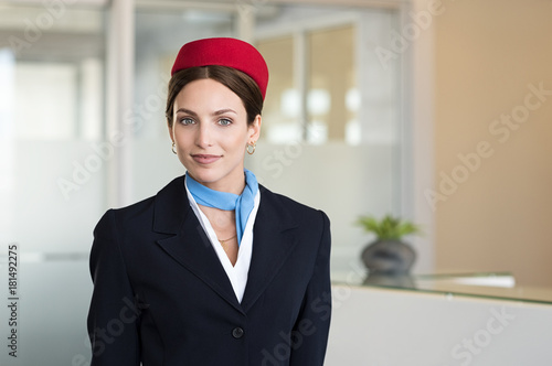 Young smiling flight assistant