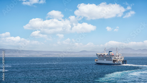 Ferry ship in navigation to the island
