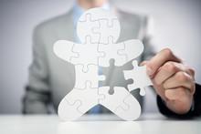 Businessman Assembling Jigsaw ...