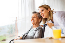 Health Visitor And A Senior Wo...