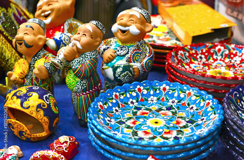Photo  Ceramic plates and  figures of Uzbek men n in traditional clothing - robe and a