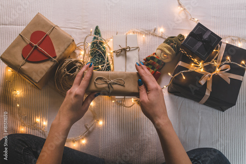 Valokuva  Overhead view of woman holding wrapped Christmas gift