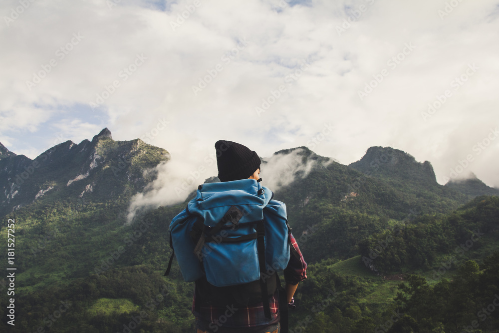Fototapety, obrazy: Asian young man in Scottish shirt and black hat hiking at mountain peak above clouds and fog Hiker outdoor. Doi Luang Chiang Dao Chiangmai Province,In morning.