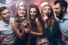 Three Beautiful Girls Sing In ...