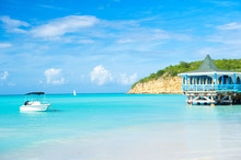 Sea Beach With Boat And Shelter In St Johns, Antigua