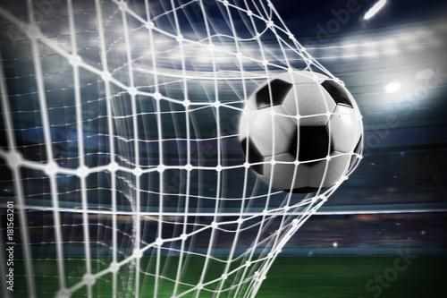 Obraz Soccer ball scores a goal on the net - fototapety do salonu