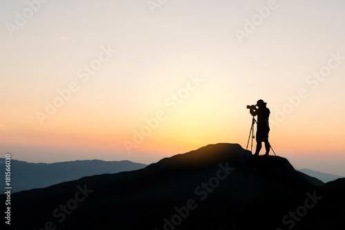 Fototapeta Silhouette photographer on top of mountain obraz na płótnie