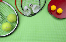 Items For Fitness , Racquets And Accessories For Badminton, Table Tennis And Tennis On A Green Background