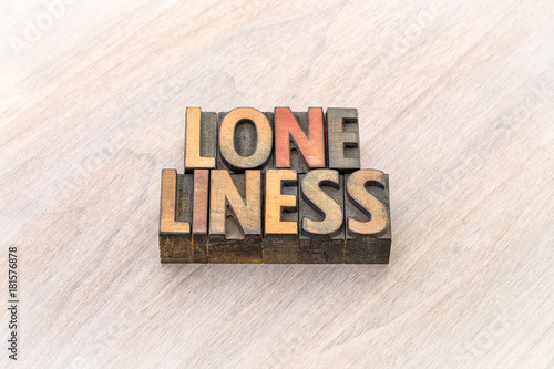 loneliness word abstract in wood type Canvas Print