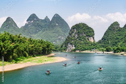 Amazing view of tourist motorized rafts on the Li River Canvas Print