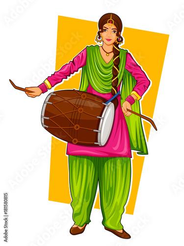 Fototapeta Sikh Punjabi Sardar woman playing dhol and dancing bhangra on holiday like Lohri