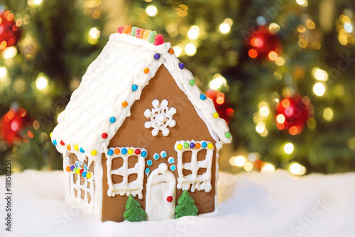 Christmas Gingerbread House Background.Homemade Christmas Gingerbread House In The Snow Decorated