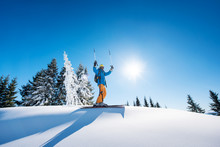 Low Angle Shot Of A Cheerful Skier Holding Ski Poles Raising His Arms In The Air Achievement Leadership Celebration Winning Victorious Happiness Positivity Gesturing Resort Riding Lifestyle Extreme