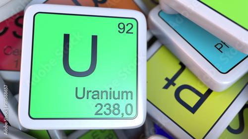 Fotografie, Obraz  Uranium U block on the pile of periodic table of the chemical elements blocks