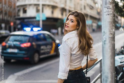 Stylish model standing at street