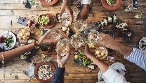 Photo Friends Toasting at Dinner Party