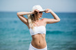 Fitness Body of Beautiful Blonde Woman on the Beach