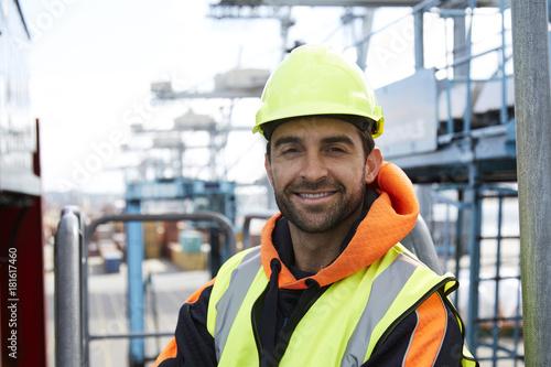 Happy docker in hardhat smiling to camera