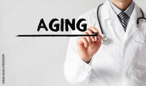 Fotografía  Doctor writing word Aging with marker, Medical concept
