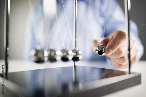 Newton's cradle businessman concept for cause and effect Wallpaper Mural